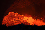 Nightime view of bursting lava bubbles through heat shimmer in lava lake in bottom of Santiago Crater of erupting Masaya Volcano, Nicaragua