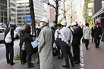 March 11, 2011, Tokyo, Japan - Office workers, some wearing hard hats, stream out of buildings to the open area as Tokyo is shook by aftereffects of Friday's powerful earthquake that struck Japan's northern area on March 11, 2011. A powerful earthquake with a magunitute of 8.9 struck Miyagi prefecture, northern Japan, causing Tsunami and damages in wide area in northern prefectures. (Photo by Akihiro Sugimoto/AFLO) [1080] -mis-
