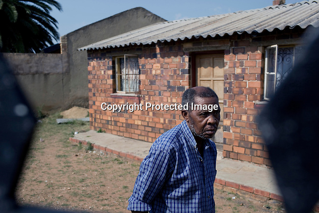 JOHANNESBURG, SOUTH AFRICA - APRIL 14: Michael Mbele, a victim of Apartheid outside his house on April 14 2010, in Soweto, South Africa. Khulumanie is involved in the Daimler complaint brought forward by victims of Apartheid. The plaintiffs argue that Daimler sold vehicles to the old South African government. (Photo by Per-Anders Pettersson/Agentur Focus For Spiegel Magazine)