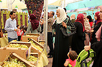 Palestinians display Grapes during the Palestinian grapes festival in the West Bank city of Hebron, on September 14, 2019. Hebron is very famous in grape production as it contains many fields of grapes, the summer is the season of harvesting. Photo by Mosab Shawer
