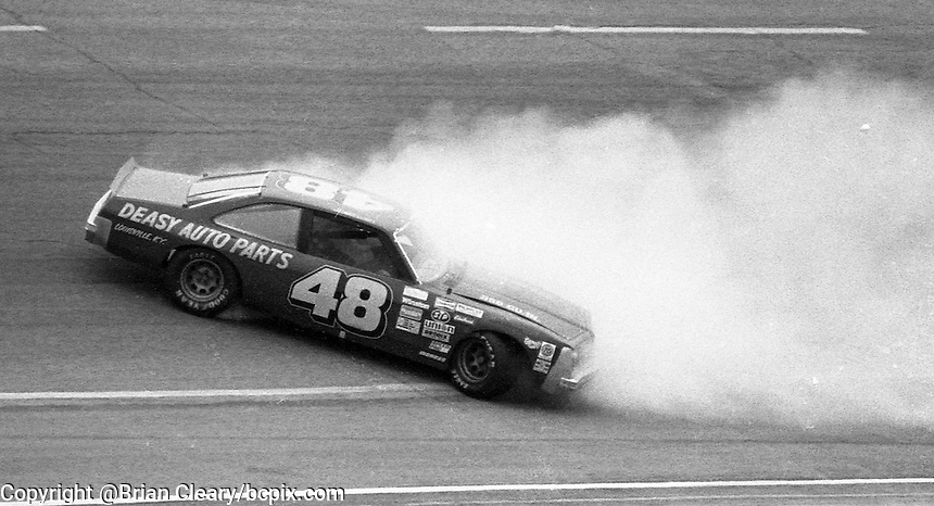 A NASCAR Busch Series car spins during a preliminary race before the Atlanta Journal 500 at Atlanta International Raceway on November 11, 1984. (Photo by Brian Cleary/www.bcpix.com)