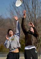 STAFF PHOTO BEN GOFF  @NWABenGoff -- 12/29/14 Thor O'Connor, 17, left, of Bentonville and Casey Kleinhenz of Fayetteville jump for the flying disc while playing in a pick up Ultimate game at Phillips Park in Bentonville on Monday Dec. 29, 2014.