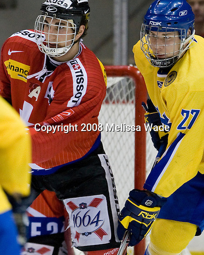 Luca Camperchioli (Switzerland - 2), Mattias Lindström (Sweden - 27) - Team Sweden defeated Team Switzerland 3-1 in the 2008 Four Nations Cup third place game in the 1980 Arena on Sunday, November 8, 2008 in Lake Placid, New York.