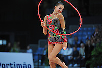 Daria Dmitrieva of Russia expresses with hoop during Event Finals at 2010 World Cup at Portimao, Portugal on March 14, 2010.  (Photo by Tom Theobald).