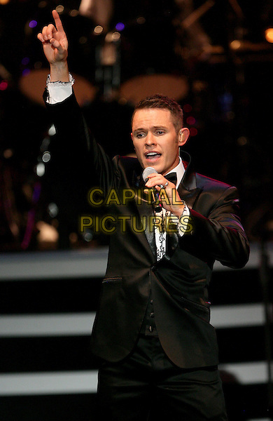 MICHAEL TIERNEY .Smokey Robinson Joins Human Nature to celebrate their 1 year anniversary at the Imperial Palace Hotel and Casino, Las Vegas, Nevada, USA, .11th  May 2010..musical show music half length microphone singing on stage black suit hand finger arm raised up .CAP/ADM/MJT.© MJT/AdMedia/Capital Pictures.