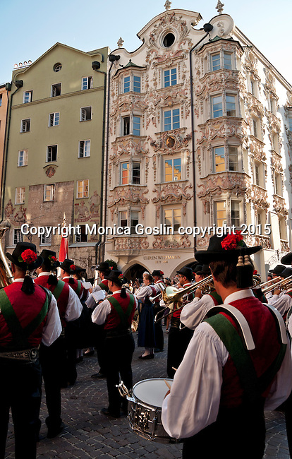 A local brass band, wearing traditional dress, plays on the plaza with the Helblinghaus in the background; there are over 300 brass bands in Tyrol and open-air concerts are held year round and have been for over 200 years