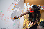 27 June, 2018, Kuala Lumpur, Malaysia : Oumou Salif of Mali marks her country of the world map in The Village on the third day at the Girls Not Brides Global Meeting 2018 at the Kuala Lumpur Convention Centre. Picture by Graham Crouch/Girls Not Brides