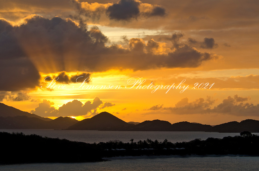 Sunset over Thatch Cay and St Thomas<br /> from St. John with Caneel in the foreground<br /> U.S. Virgin Islands