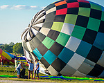 A near record crowd hot air balloon fans filled the hillsides at the National Balloon Classic launch field July 29 for opening ceremonies, balloon launches and music. Balloon crew worked fast in a quick wind to get their balloons filled with air.