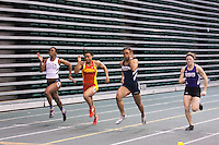 Lincoln's Nickeisha Beaumont (far left), PIttsburg State's Rosalyn Nelson, Lincoln's Latoya King, and SBU's Corie Chuning spring to the finish of the 60 meter dash at the 2012 MIAA Indoor Track & Field Championships at Missouri Southern in Joplin, Sunday, February 26.