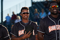 Jupiter Hammerheads Jose Devers (1) and Lazaro Alonso (right) during the national anthem before a Florida State League game against the Bradenton Marauders on April 20, 2019 at LECOM Park in Bradenton, Florida.  Bradenton defeated Jupiter 3-2.  (Mike Janes/Four Seam Images)