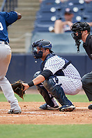 Tampa Tarpons catcher Keith Skinner (10) waits to receive a pitch in front of home plate umpire Mark Stewart during a game against the Lakeland Flying Tigers on April 8, 2018 at George M. Steinbrenner Field in Tampa, Florida.  Lakeland defeated Tampa 3-1.  (Mike Janes/Four Seam Images)