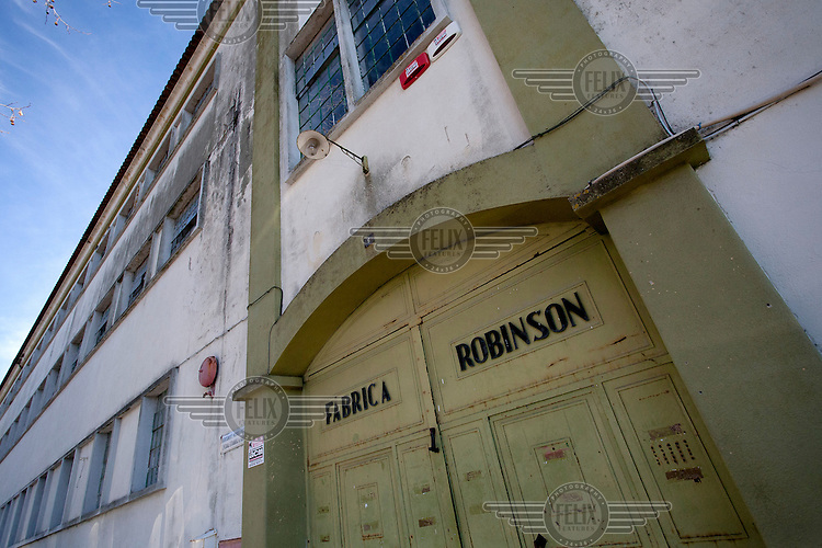 The main entrance to the Robinson cork factory. The factory was founded in 1840 and stayed in production till 2009, at which time it was still partially powered by steam energy. At its peak the company employed 2000 labourers and cork is still Portugal's most important export product. /Felix Features