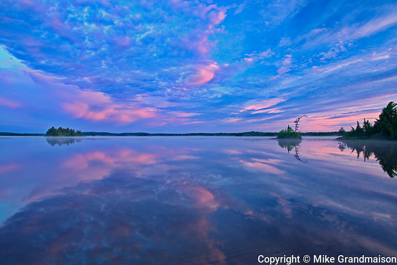 Reflection on Lac des Sables at sunrise<br />