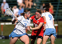 Corey Donohoe (7) of North Carolina tries to use the pick of teammate Jenn Russell (9) to free herself away from Caroline Helmer (10) of Cornell at St. Stephens and St. Agnes High School in Alexandria, VA.  North Carolina defeated Cornell, 13-7.