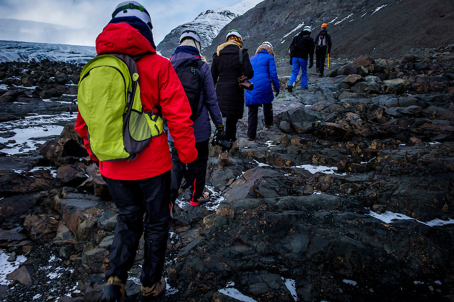 JOKULSARLON, ICELAND - CIRCA MARCH 2015: Group of tourists hiking near the Glacial Lagoon in the  Vatnajökull National Park to visit Ice Caves.