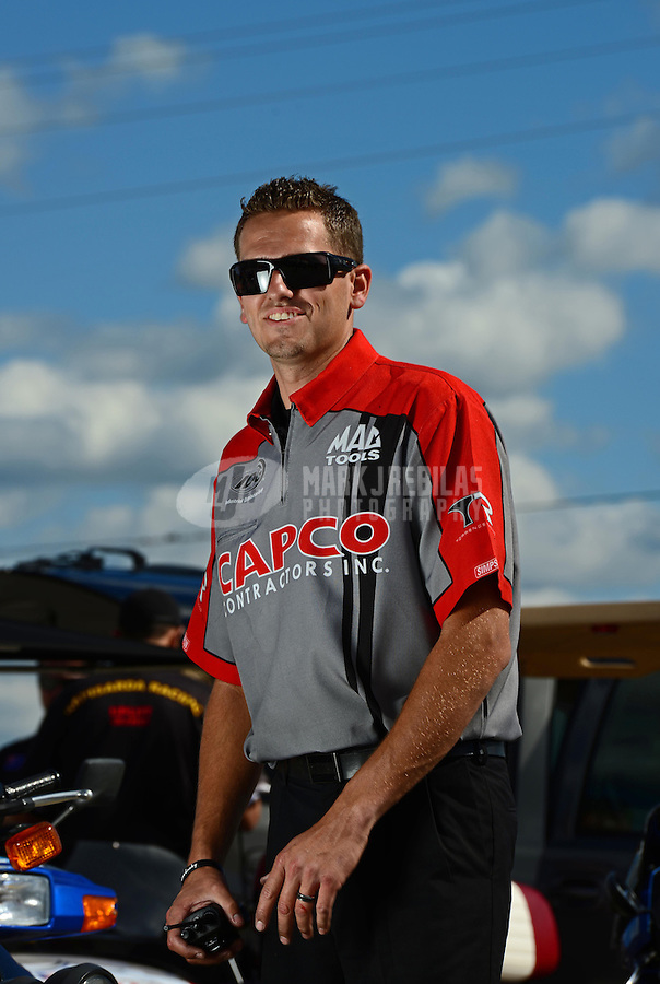 Sept 8, 2012; Clermont, IN, USA: Gary Pritchett NHRA crew member for top fuel dragster driver Steve Torrence during qualifying for the US Nationals at Lucas Oil Raceway. Mandatory Credit: Mark J. Rebilas-
