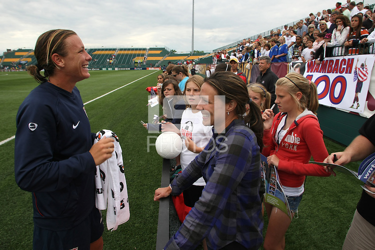 USWNT's Abby Wambach, left greets friend and teammate on the Washington Freedom Sarah Huffman following the game in which she scored her 100th career goal in the second half. The U.S. Women's National Team defeated Canada 1-0 in a friendly match at Marina Auto Stadium in Rochester, NY on July 19, 2009.