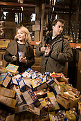 Ronda Michaels, left, and Paul Piracci, attempt to illustrate, perhaps poorly,  the current ecominc recession's effects in regards to disapearing food donations inside the NC Food Bank in Durham, NC.  Both models are wearing selecting clothing from Brightleaf Square?s Vert & Vouge and volunteered  at the food bank on Friday, Dec. 6, 2008, with coworkers from Empower Personal Training and students from Duke University. .