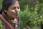 Rosa Lorenzo smells a plant at an eco-agricultural training center in Comitancillo, Guatemala. The center is sponsored by the Maya Mam Association for Investigation and Development (AMMID).