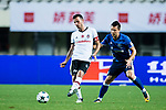 Besiktas Istambul Midfielder Oguzhan Ozyakup (L) plays against FC Schalke Midfielder Yevhen Konoplyanka (R) during the Friendly Football Matches Summer 2017 between FC Schalke 04 Vs Besiktas Istanbul at Zhuhai Sport Center Stadium on July 19, 2017 in Zhuhai, China. Photo by Marcio Rodrigo Machado / Power Sport Images