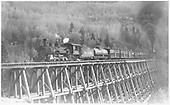 Engine #461 with engine #462 cut in mid-train with 33 cars crossing bridge 45-A.<br /> RGS  Ophir Loop, CO  Taken by Perry, Otto C. - 10/4/1947