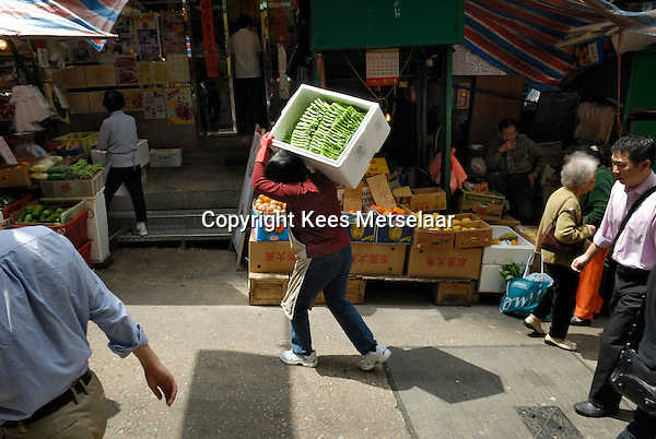 Hong Kong, 23 March 2007..Fresh fruit and vegetables in the Graham Street market area in old Hong Kong.<br /> Photo Kees Metselaar