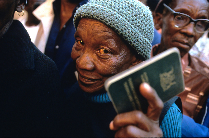 A woman holds her identity papers before casting her ballot at a polling station in Soweto.    Millions of South Africans voted in the nation's first free and democratic general election,  marking the end of centuries of apartheid rule.  Nelson Mandela of the African National Congress (ANC) was elected as the first black President of South Africa..