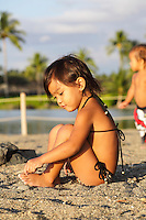 Young children play at 'Anaeho'omalu Beach, Big Island of Hawai'i.