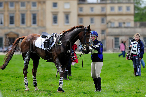 2009 Mitsubishi Motors Badminton Horse Trials.Baminton UK.The Cross country phase:.Zara Phillips (GBR) pulls up Ardfield Magic Star and retires with Badminton House in the background.The 3 day event was won by Oliver Townend (GBR) riding Flint Curtis..