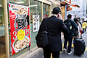 Pedestrians walk in front of a Yoshinoya restaurant on April 6 in Shinjuku, Tokyo. Yoshinoya Holdings Co. Ltd., announced on Wednesday the re-introduction on its butadon menus (pork-on-rice bowl) starting April 6, more than four years after the dishes were removed from its menu. The butadon, introduced in March 2004 as an alternative to Gyudon (beef-on-rice bowl,) was removed from the menu on December 2011, when Gyudon sales resumed after the end of the embargo on US beef following the discovery of the country's first mad cow disease case in 2004. (Photo by Rodrigo Reyes Marin/AFLO)