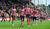 Lincoln City's Michael Bostwick, centre, celebrates scoring his sides second goal with team-mates John Akinde, left, and Harry Anderson<br /> <br /> Photographer Chris Vaughan/CameraSport<br /> <br /> The EFL Sky Bet League Two - Lincoln City v Swindon Town - Saturday 11th August 2018 - Sincil Bank - Lincoln<br /> <br /> World Copyright &copy; 2018 CameraSport. All rights reserved. 43 Linden Ave. Countesthorpe. Leicester. England. LE8 5PG - Tel: +44 (0) 116 277 4147 - admin@camerasport.com - www.camerasport.com