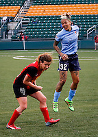 Rochester, NY - May 21, 2016: Western New York Flash's Elizabeth Eddy (4) and Sky Blue FC's Tasha Kai (32) during a National Women's Soccer League (NWSL) match at Sahlen's Stadium. The Western New York Flash go on to win 5-2.
