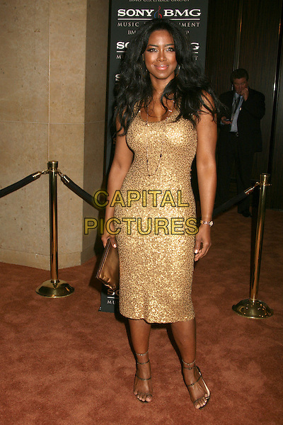 KENYA MOORE.Clive Davis 2007 Pre-Grammy Awards Party at the Beverly Hilton Hotel, Beverly Hills, USA..February 10th, 2007.full length gold dress .CAP/ADM/BP.©Byron Purvis/AdMedia/Capital Pictures
