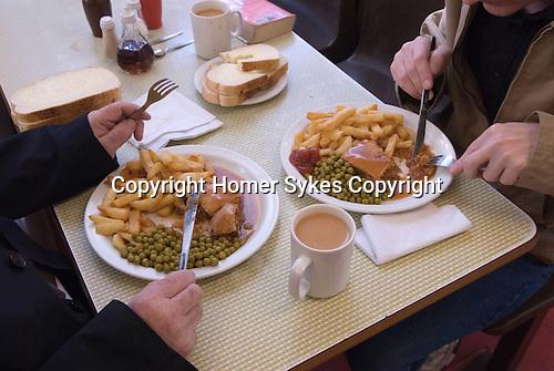 Steak and Kidney pie, chips and mushy peas mugs of tea. Lunch. Regency Café Westminster London SW1 UK.