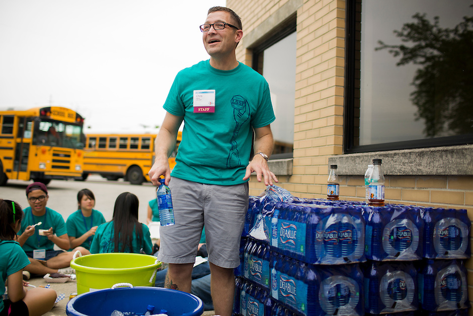 "CKI administrator Chris Martz hands out water at lunch during ""Circle the City with Service,"" the Kiwanis Circle K International's 2015 Large Scale Service Project, on Wednesday, June 24, 2015, in Indianapolis. (Photo by James Brosher)"