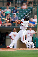 Rochester Red Wings right fielder LaMonte Wade (11) follows through on a swing during a game against the Lehigh Valley IronPigs on June 30, 2018 at Frontier Field in Rochester, New York.  Lehigh Valley defeated Rochester 6-2.  (Mike Janes/Four Seam Images)