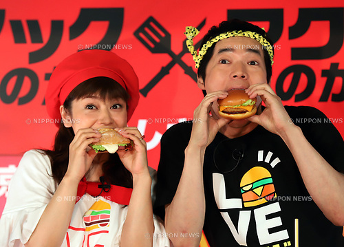 "August 7, 2017, Tokyo, Japan - Japanese actress Airi Taira (L) and comedian Koji Imada display McDonald's new burgers ""Roast Beef Burger"" (L) and ""Beef Cutlet Burger"" in Tokyo on Monday, August 7, 2017. McDonald's Japan will start a new campaign of ""Mac (Tokyo) vs McD (Osaka)"" from August 9.  (Photo by Yoshio Tsunoda/AFLO) LwX -ytd-"