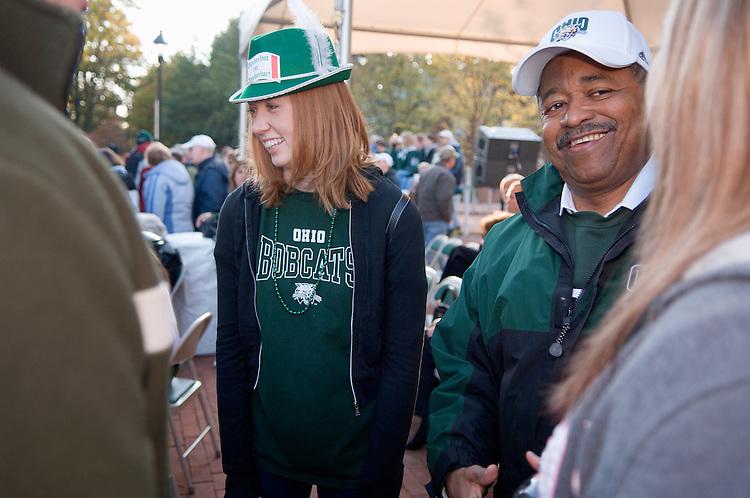 Lauren Jensen, Michael Easterday '05(hat)Kristen Jensen '05, and Dr. McDavis