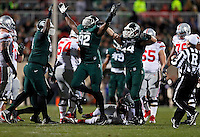 Michigan State Spartans defensive lineman Joel Heath (92) celebrates a sack of Ohio State Buckeyes quarterback J.T. Barrett (16) during the first quarter of the NCAA football game at Spartan Stadium in East Lansing, Michigan on Nov. 8, 2014. (Adam Cairns / The Columbus Dispatch)