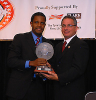 Luciano Emilio receives Honda MVP award from DC United general manager Dave Kasper.  DC United 4th Annual Awards Reception honoring player achievements for the 2007 season took place  at the Ronald Reagan Building in Washington, DC on October 22, 2007.