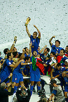 Jul 9, 2006; Berlin, GERMANY; Italy defender (5) Fabio Cannavaro hoists the World Cup trophy with teammates after defeating France 5-3 on penalty kicks following a 1-1 draw after extra time in the final of the 2006 FIFA World Cup at the Olympiastadion, Berlin. Mandatory Credit: Ron Scheffler-US PRESSWIRE Copyright © Ron Scheffler