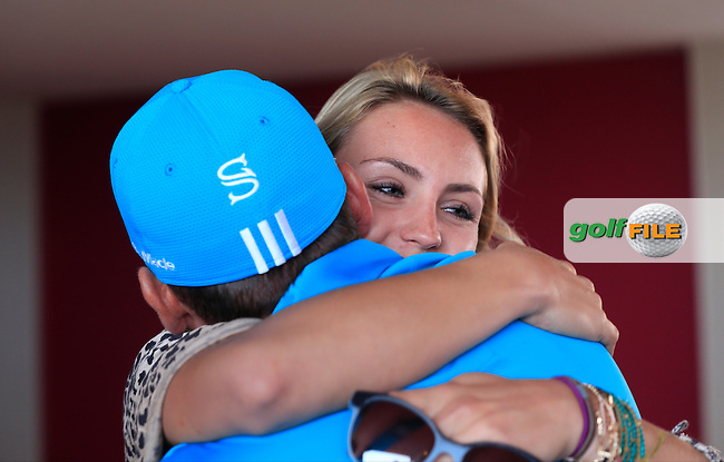 Sergio Garcia (ESP) gets a hug from girlfriend Katharina Boehm after winning the tournament after a 3 hole playoff with Mikko Ilonen (FIN) during Saturday's Final Round of the Commercial Bank Qatar Masters 2014 held at Doha Golf Club, Doha, Qatar. 25th January 2014.<br /> Picture: Eoin Clarke www.golffile.ie
