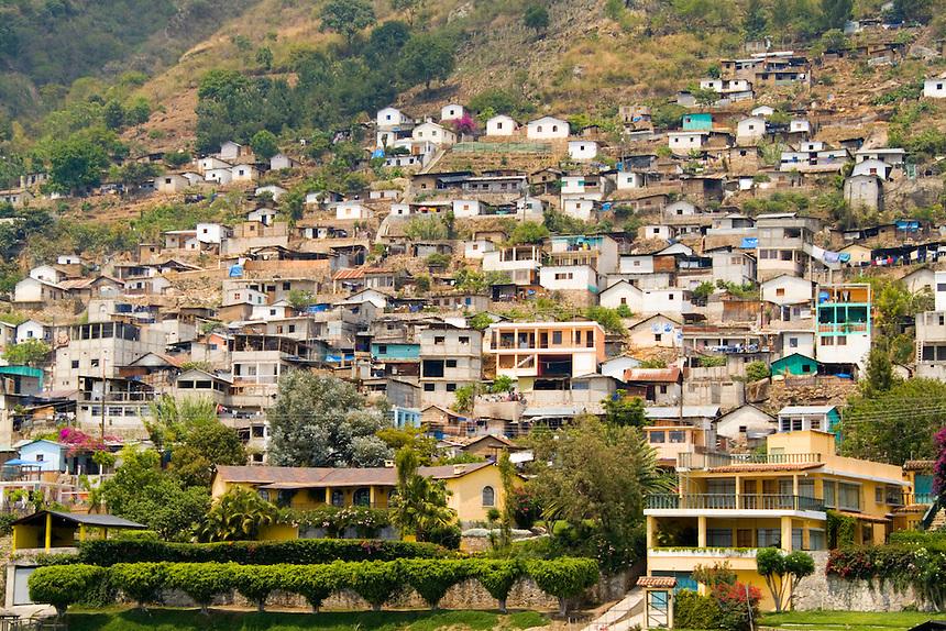 Village of San Antonio from boat on water of remote Lake Atitlan in Guatemal