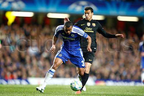 18.04.2012. Stamford Bridge, Chelsea, London. Chelsea's Ashley Cole and Pedro RodrÌguez of  FC Barcelona during the Champions League Semi Final 1st  leg match between Chelsea and Barcelona  at Stamford Bridge, Stadium on April 18, 2012 in London, England.............