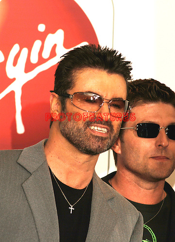 """George Michael makes an In-Store Appearance for New CD """"Patience"""" at the Virgin Megastore in Hollywood, May 21st 2004. With him is partner Kenny Goss."""
