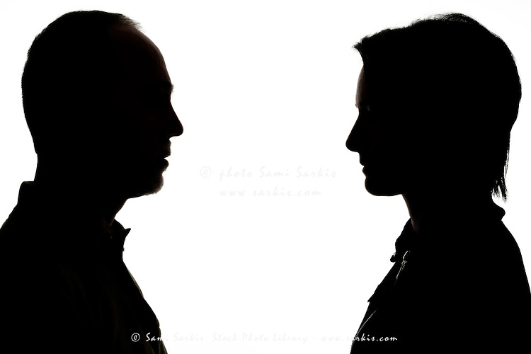 Silhouette of man and woman face to face
