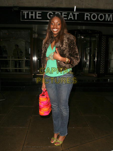 MAKOSI MUSAMBASI.Leaving The TRIC Awards (Television & Radio Industries Club) at the Great Room, Grosvenor House, Park Lane, Londnn, UK..March 7th, 2006.Ref: AH.full length jeans denim brown fur jacket pink orange bag.www.capitalpictures.com.sales@capitalpictures.com.© Capital Pictures.