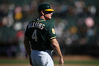 OAKLAND, CA - SEPTEMBER 8:  Third base coach Matt Williams #4 of the Oakland Athletics works during the game against the Texas Rangers at the Oakland Coliseum on Saturday, September 8, 2018 in Oakland, California. (Photo by Brad Mangin)