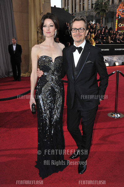 Gary Oldman & Alexandra Edenborough at the 84th Annual Academy Awards at the Hollywood & Highland Theatre, Hollywood..February 26, 2012  Los Angeles, CA.Picture: Paul Smith / Featureflash